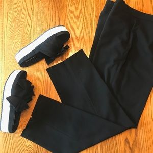 Black dress pants, ankle length, size 8.